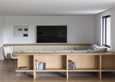Making full use of the parkland views below, Apartmento Villa Lobos by Felipe Hess is an understated family home, beautified by neutral tones and features.