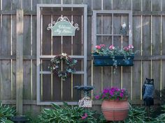 I used our old screen door and window to decorate one of my fence panels in my garden =)