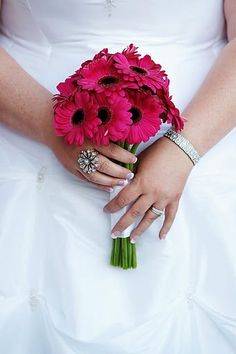 ok, so i like the one color thing going on. what if each bridesmaid just carried a coordinating color. red carries green....green carries red....pink carries blue....blue carries pink