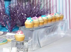 Mini cupcakes on an upside-down glass vase to give the illusion of sitting on ice blocks