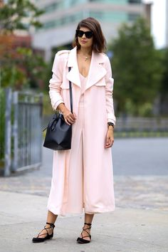 A pink blush coat and dress with a Mansur Gavriel bucket bag