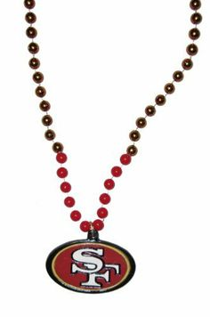 "San Francisco 49ers NFL Bead Necklace with Team Medallion by NFL. $5.49. Officially Licensed. Large Logo Medallion. Team Color Beads. 17"" Long Necklace (plus length of medallion). NFL Bead Necklace with Team Medallion"