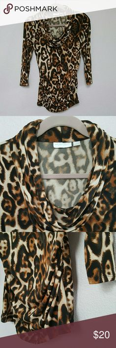 New York & Co. Leopard Print Top Gorgeous & super comfy cowl neck top! 3/4 length sleeves and gathered sides for a form fit. Nice stretchy material is soft and also keeps the colors bright.   95% Polyester ? 5% Spandex   Thanks for looking & Happy Poshing! New York & Company Tops Blouses