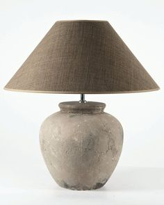 This is a lovely table lamp in natural terracotta with an aged grey finish. The…