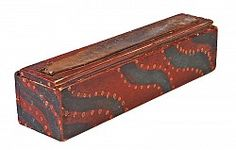 Great Paint Decorated Sharpening Box. Northeas, with paint-precedents in Pennsylvania and New England. Early to mid-19th century. Pine. Crisply made with a fine-Federal dovetailed case. Vivid, dry, paint decoration of blue-green serpentine swaths on a barn-red ground with whimsical trailing salmon-colored dots. The sliding lid with thumbnail molded sides. The top of the lid has always been fitted with a leather strip, presumably used to sharpen blades. 11 1/2 inches long x 3 wide x 2 7/8…