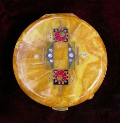 "ART DECO CELLULOID COMPACT - I see a trend. I don't know if  ""we who are average"" have noticed, but fashion is going all the way to, at least, the ""Victorian/Edwardian-fashion days"" where we carried gloves, strove to have items like this item to our right; a personal-compact, hats, hat-pins etc. Check out  your opening-page and notice what's being shown more and more. My prediction for 2015"