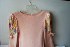 Luxurious vintage 80s pastel pink , knit dress with a multicolored sequins on the sleeve .Made by Don Sayres . Size 10.
