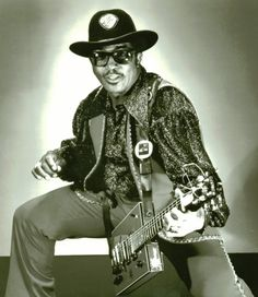 Bo Diddley | Ellas Otha Bates (December 30, 1928 – June 2, 2008), known by his stage name Bo Diddley, was an American R&B vocalist, guitarist and songwriter (usually as Ellas McDaniel). He was also known as The Originator because of his key role in the transition from the blues to rock and roll, and rock, influencing a host of acts, including The Rolling Stones, Pink Floyd, Parliament Funkadelic, The Velvet Underground, The Who, The Yardbirds, Eric Clapton, and The Beatles, among others.