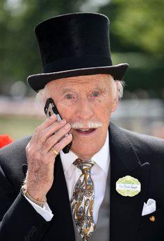 Sir Bruce Forsyth on his mobile phone