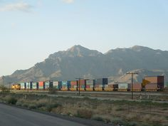 Train in Arizona, USA, with 20 and 40 foot containers double stacked in well cars