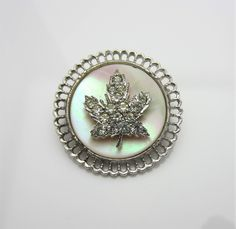 Vintage Costume Jewellery Brooch Pin Rhinestone Encrusted Maple Leaf Design Mother Of Pearl Disc Inlay Filigree Frame 1950s By Keyes Canada by AdornAnewVintage on Etsy #AdornAnew #EtsyShop #VintageJewellery