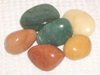 Aventurine - Is a form of quartz, characterized by its translucency and the platy mineral inclusions that give a shimmering or glistening effect termed aventurescence.  Usually green, but it may also be orange, brown, yellow, blue, or gray.  Aventurine is used for landscape stone, building stone, aquaria, monuments, and jewelry.  (not to be confused with (artificially made glass) goldstone.