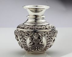 A traditional silver pot with an imagery of goddess lakshmi...