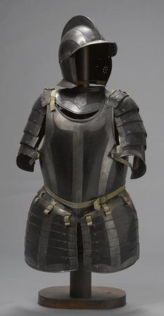 A German black and white half-suit of armor  late 16th/early 17th century