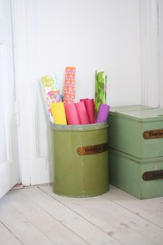 white walls with pops of colour from bins and wrapping paper.