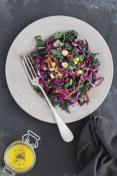 Kale and red cabbage slaw with turmeric tahini dressing. #vegan
