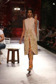 Monisha Jaising at India Couture Week 2014 - orange cigarette pants with cream jacket