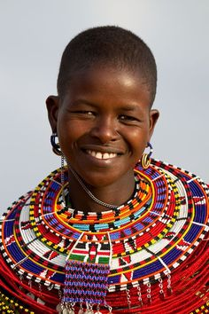 Pretty smile of a woman from Samburu, Kenya, adorned in the traditional jewelry of multi-beaded necklaces