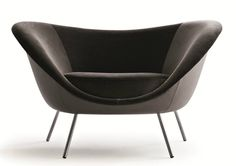 """Designed by Gio Ponti Dimensions: 47 1/4""""W x 31 7/8""""D x 29 1/8""""H(16 1/8""""seat height) Materials: Fabric, leather Made in Italy The armchair was designed for one of the projects closest to Gio Ponti's h"""