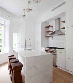 bright white kitchen with subway tile backsplash marble waterfall countertop and raw wood accents Kitchen Tiles, Kitchen Flooring, Kitchen Countertops, New Kitchen, Kitchen Dining, Kitchen Decor, Marble Counters, Cozy Kitchen, Kitchen Modern