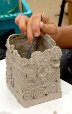 Coil Pots - Clay Handbuilding Lessons. (Also, this site has tons of free art lesson ideas and references)