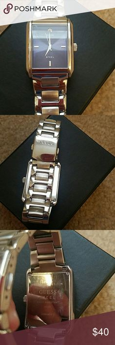 Men's Guess Watch Navy Blue face with small diamond at the 12:00 position. Some wear and minor scratches reflected in price. Guess Accessories Watches