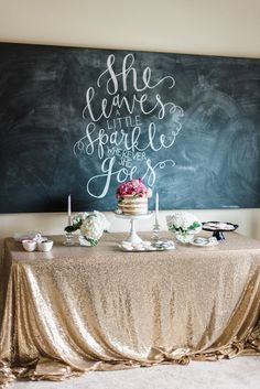 """A sparkly gold sequin tablecloth and blackboard backdrop was a pretty presentation for dessert. A """"She leaves a little sparkle wherever she goes"""" quote was the perfect touch! 