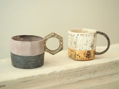 kazuhiro katase. I like the cup on the right, but I would like to see it with the handle on the left