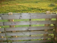Pallets slipped over fence posts = Instant Fence