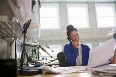 Stock Photo : Businesswoman using phone in modern office