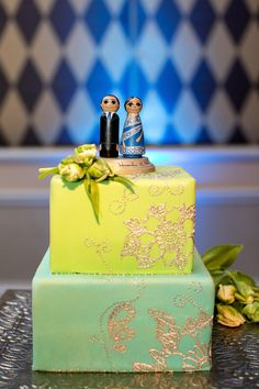 yellow and mint green wedding cake with gold henna design pattern
