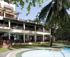 Neptune Beach Hotel is located on Bamburi Beach, approximately 15 minutes drive north of Mombasa town.  All 80 bedrooms are air-conditioned with private bathroom and balcony. Facilities include restaurants, discotheque, bars, TV lounge, swimming pool and floodlit tennis courts nearby. Windsurfing, catamarans, deep sea fishing, scuba diving and boat trips can be arranged. The Resort boasts of 78 elegantly furnished rooms, with spectacular view of lush tropical gardens. Beach Hotels, Beach Resorts, Neptune Beach, Christmas Destinations, Tropical Gardens, Mombasa, Recreational Activities, Deep Sea Fishing, North Coast