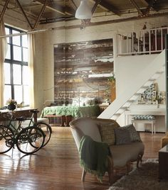 A rustic loft accented by soft colors & worn exposed brick walls.