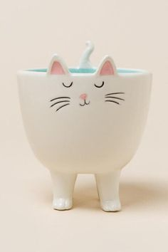 This decorative kitty bowl is the purr-fect accessory for the cat lover's home.