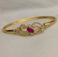 CZ and ruby stone kada Code : BAK 379 Price : Whatsapp to for order processing. Gold Jewelry Simple, Gold Rings Jewelry, Garnet Jewelry, Gold Bangles, Pendant Jewelry, Beaded Jewelry, Jewelery, Baby Jewelry, Bangle Bracelets