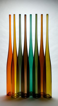 db Glassworks orange, yellow, charcoal, brown, teal, olive, rust; would be amazing in the bay window come fall!