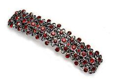Spinka z francuskim automatem o długości 8 cm, wysadzana czerwonymi kryształowymi kamieniami znanej firmy Preciosa. Produkt galwanizowany w kolorze starego srebra. Spinki francuskie są trwałe, doskonale trzymają włosy i pięknie się prezentują. Prawdziwy szyk i elegancja.