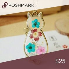 RESTOCKED Floral Cat Necklace This might just be the cutest cat necklace in the world. Antique bronze frame and pressed flowers enclosed in a little kitty cat.  2x1 in pendant  27 in chain Jewelry Necklaces