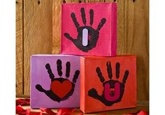 Make these adorable canvases with the kids to preserve Valentine's Day memories for years to come.