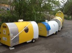 Shelter pods built by formerly homeless man: designed to provide shelter, accommodate a sleeping bagged sleeper & a kerosene lamp (vented for the fumes)
