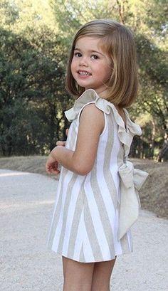 Vestido niña a rayas beige y blancas de Ancar                                                                                                                                                                                 Más