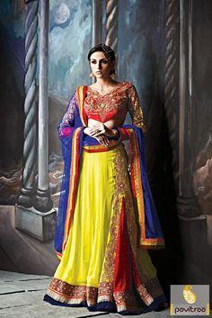 Pavitraa Yellow, Red with Blue Bridal Lehenga Choli #lehengasonline #lehengacholionline #designerlehengas #weddinglehengas