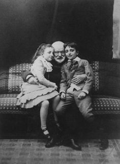 Victor Hugo with his grandchildren, Georges and Jeanne Hugo.