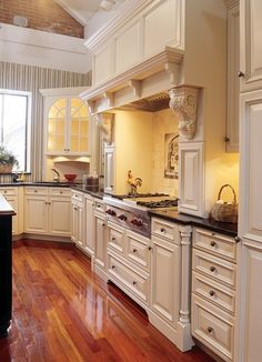 White french country kitchen, beautiful cabinets, brick, hardwood floors, wonderful stove top and masonry cover, and mosaic...almost my kitchen!