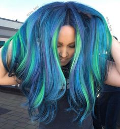For my underlights     my Laser Lights technique I did on my client Joey#aurora @kenraprofessional neon green, neon blue and neon Violet with regular creative teal and Violet charcoal concoction! #northernlights #neonmania @hairbesties_