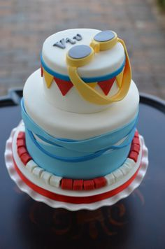 Swimming pool themed birthday cake with goggles.
