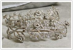 A diamond and pearl tiara with masses of flower heads and leaves.