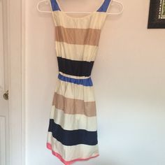 Stripes patterned dress Very beautiful dress. The back is the best part with a love cut and bow. It's a great summer/spring dress paired with some wedges. Brand new never worn just bought the wrong size. Forever 21 Dresses Mini