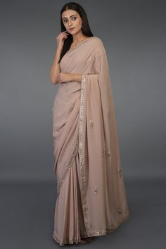 From our wedding couture collection, this is an exquisite Rose Gold Zardozi and Gota Patti hand embroidered saree and blouse crafted in Oyster Pink pure crepe silk. The blouse has zardozi and gota patti floral bootahs embroidered all over with go Indian Wedding Outfits, Indian Outfits, Indian Clothes, Dress Indian Style, Indian Dresses, Farewell Sarees, Gota Patti Saree, Clothes, Fashion Clothes
