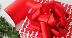 RED PEBBLES Gift Wrap. Made in Sweden. Paired together with Red Matte Curling Ribbon in 10mm and 31mm widths.